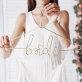 Metalna vješalica Bride zlatna 45x27 cm