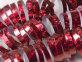 Spiralne trake sa šljokicama crvene
